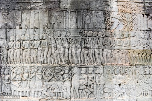 1147569123 istock photo Bas relief of Bayon Temple, Angkor Thom, Siem Reap, Cambodia 950659004