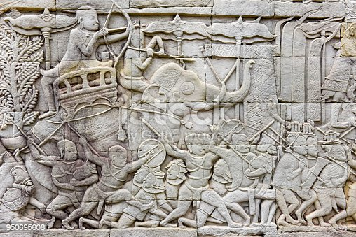 1147569123istockphoto Bas relief of Bayon Temple, Angkor Thom, Siem Reap, Cambodia 950695608