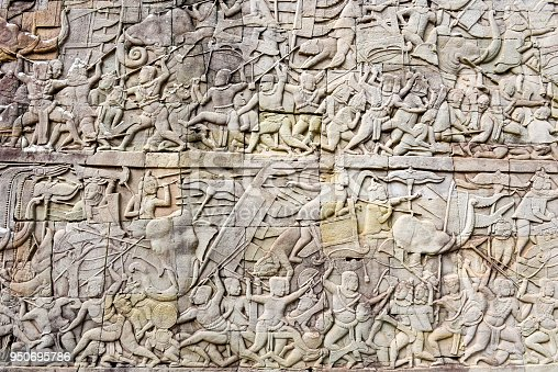 1147569123istockphoto Bas relief of Bayon Temple, Angkor Thom, Siem Reap, Cambodia 950695786