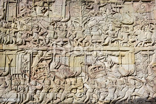 1147569123istockphoto Bas relief of Bayon Temple, Angkor Thom, Siem Reap, Cambodia 950698016