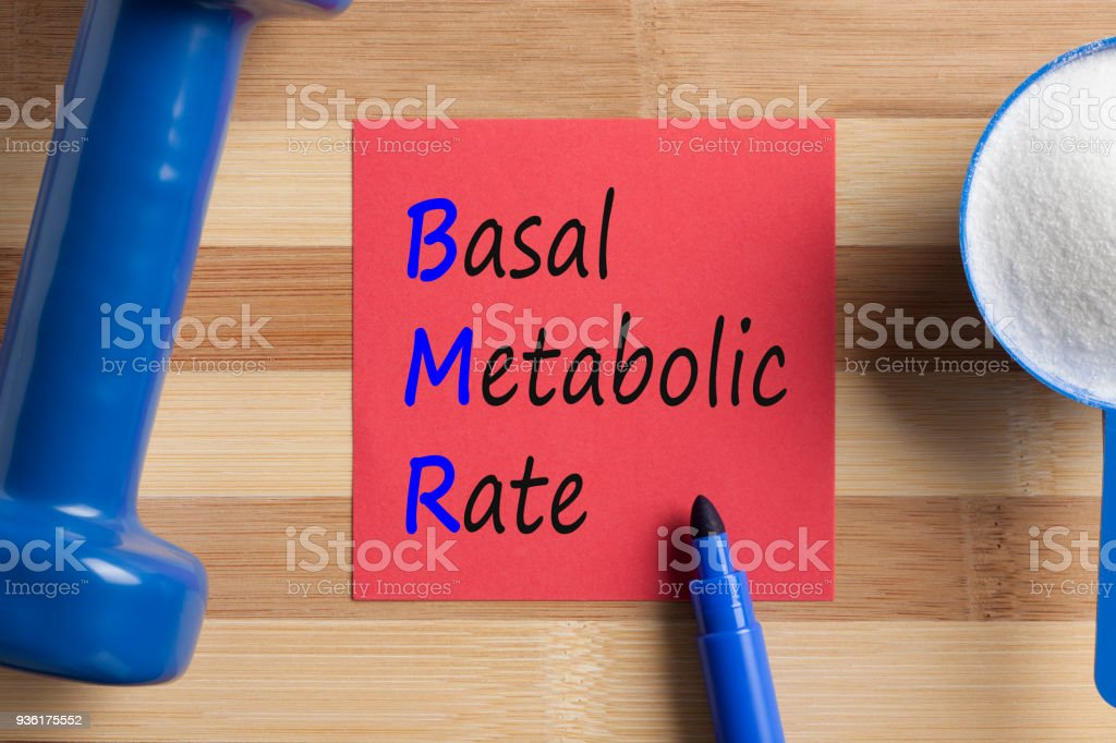 BMR Basal metabolic rate written on note stock photo