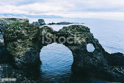 istock Basalt formations at the coastline between Arnarstapi and Hellnar in Iceland. 876975490
