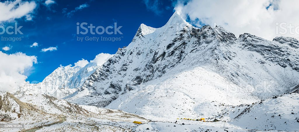 Base camp tents remote snowy mountain peaks panorama Himalayas Nepal stock photo