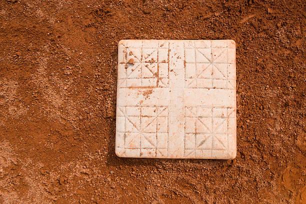 base in a baseball field close up stock photo