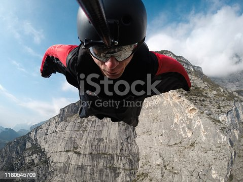 base jumper in flight from the cliff, base jumping, wingsuit