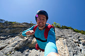 Base jumper launches off cliff while smiling at camera