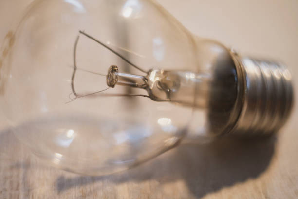 base lamp on a wooden table glare on the background stock photo