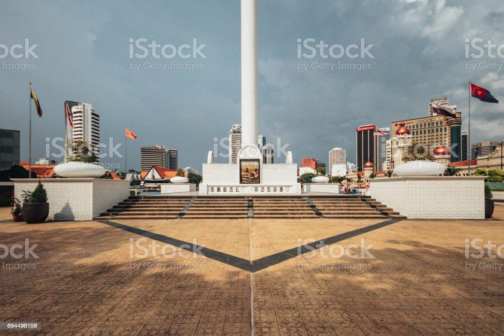 Base of The flag with cloudy sky in Kuala Lumpur, Malaysia. stock photo