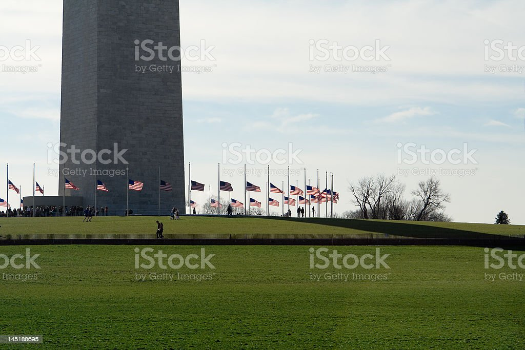 Base of Washington Monument Surrounded by American Flags stock photo