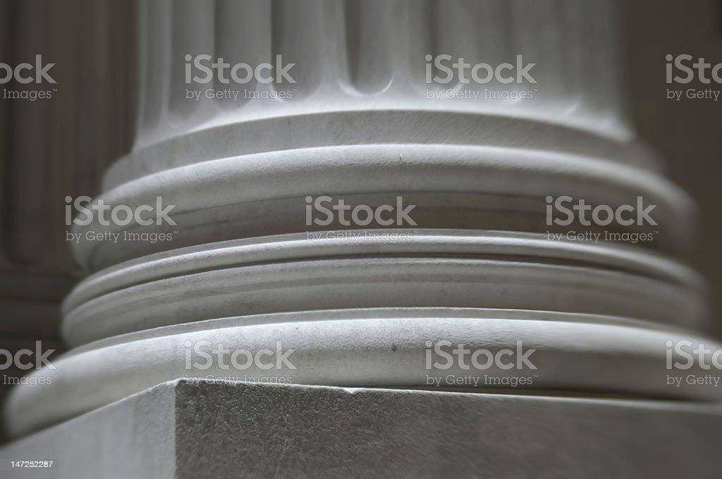 base of white pillar column sharp and defocused stock photo