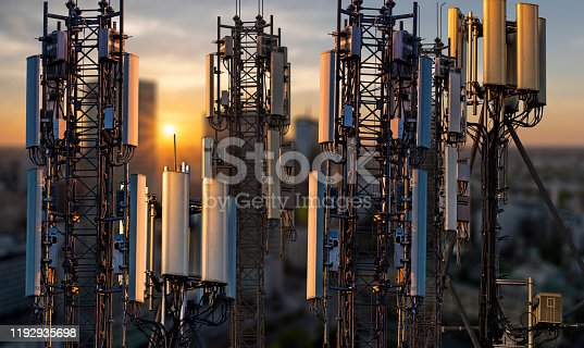 base stations and mobile phone transmitters against the backdrop of a modern city