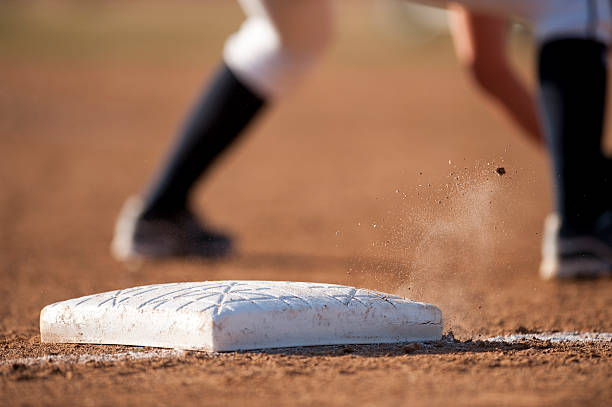 base with flying dirt - spring training stock photos and pictures