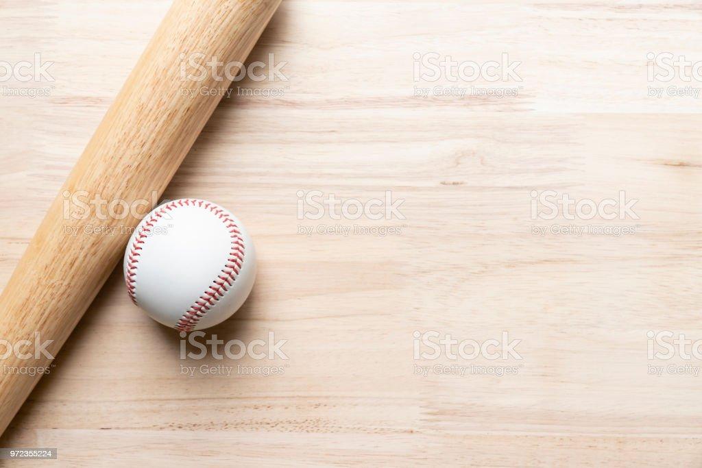 baseball and baseball bat on wooden table background, close up stock photo