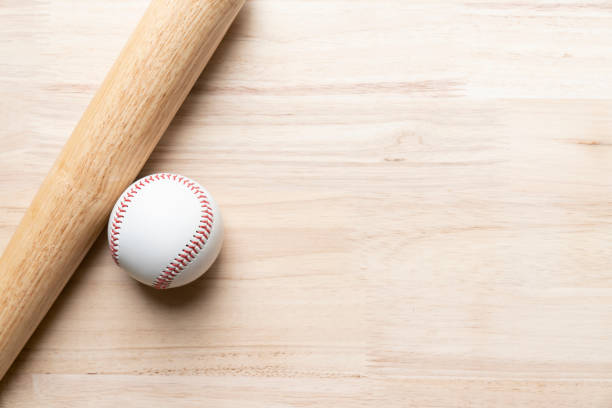 baseball and baseball bat on wooden table background, close up - baseball стоковые фото и изображения