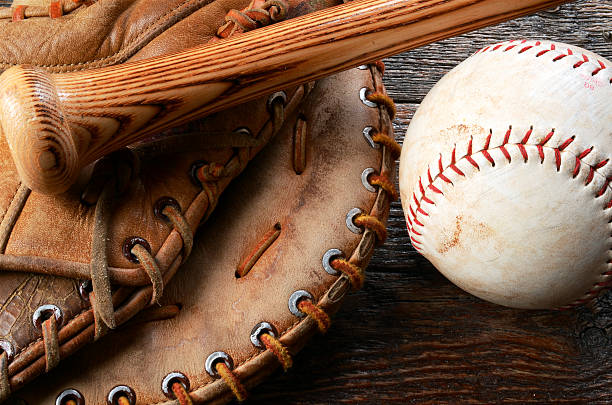 Baseball and Baseball Glove A top view image of an old used baseball, baseball glove, and baseball bat.  baseball sport stock pictures, royalty-free photos & images