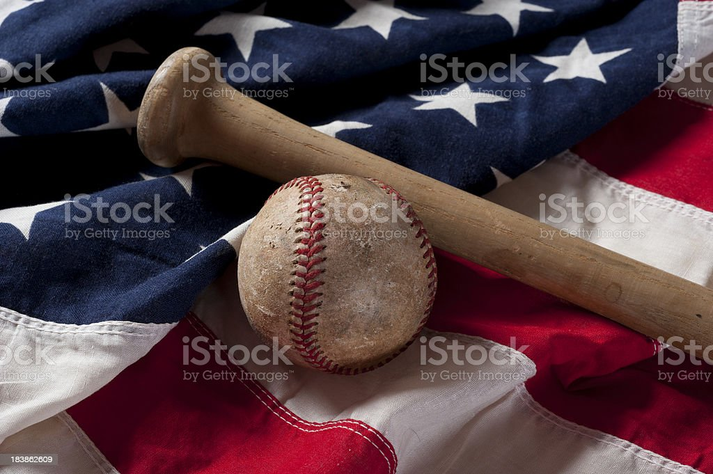 baseball and bat on American Flag royalty-free stock photo