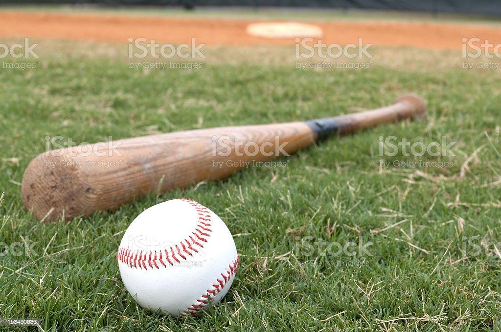 Baseball and Bat on Field stock photo