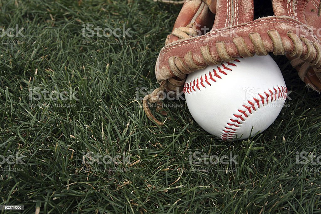 Baseball and Glove on Green Grass royalty-free stock photo