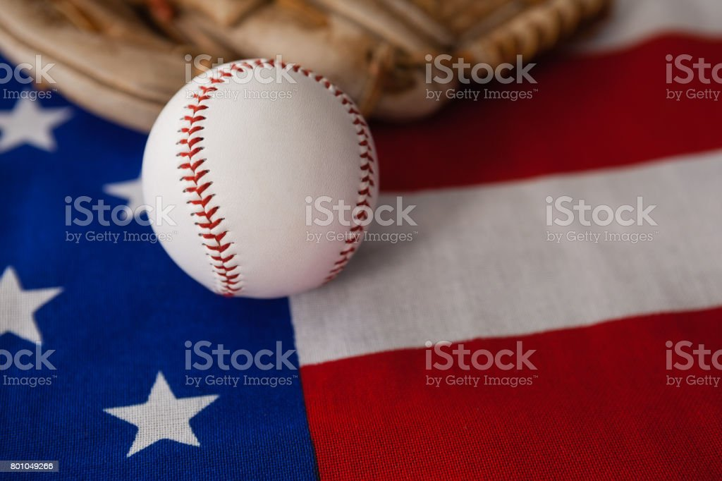 Baseball and gloves on an American flag stock photo