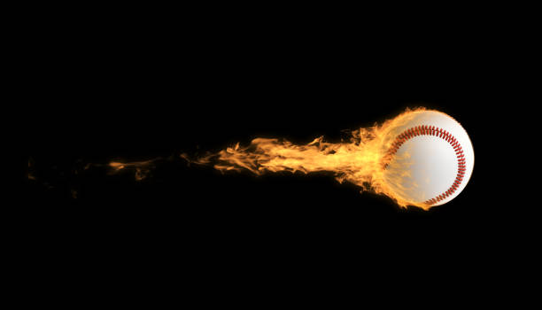 Baseball Ball In Flames Over Black Background stock photo