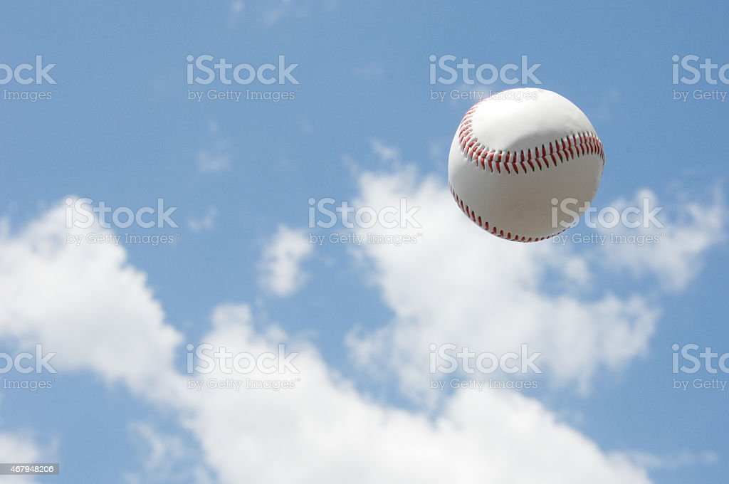 Baseball ball in the sky stock photo