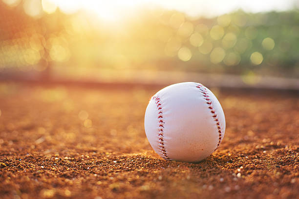baseball ball on pitchers mound - softball stock photos and pictures