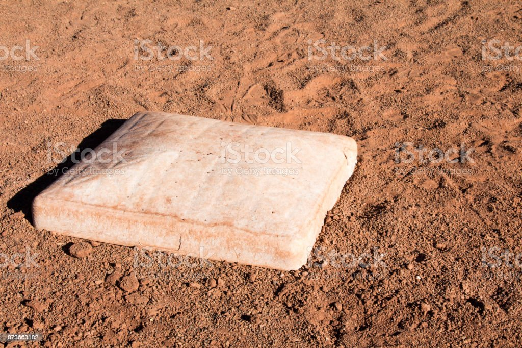 Baseball base in the dirt stock photo