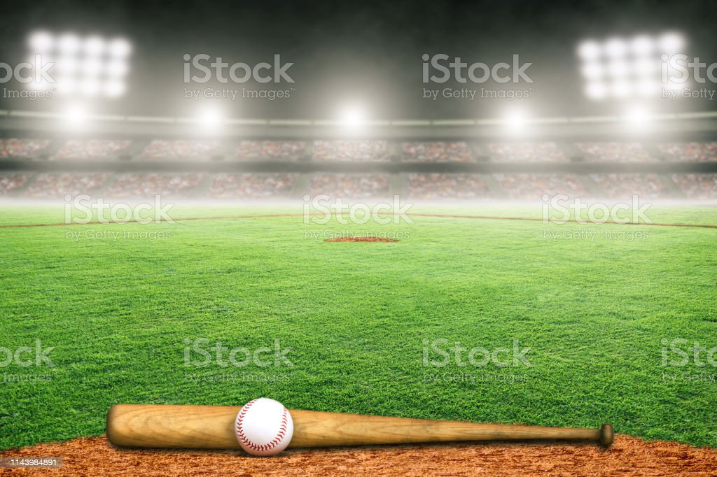 Baseball bat and ball on field at brightly lit fictitious outdoor...