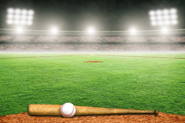 Baseball Bat and Ball on Field in Outdoor Stadium With Copy Space Baseball bat and ball on field at brightly lit fictitious outdoor stadium. Focus on foreground and shallow depth of field on background and copy space. baseball diamond stock pictures, royalty-free photos & images