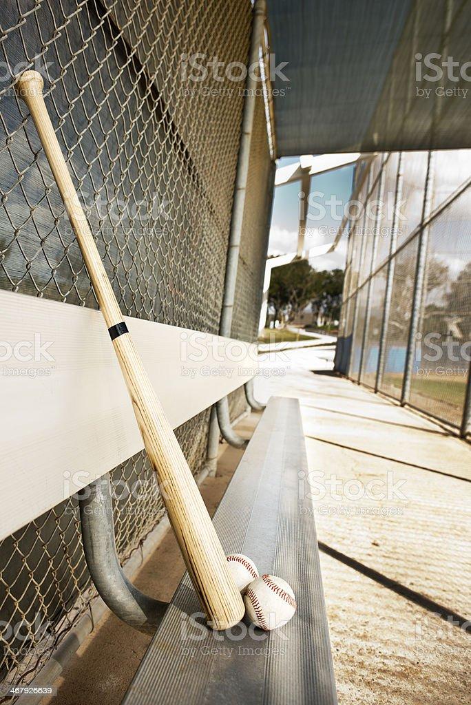 Baseball bat and balls in dugout stock photo