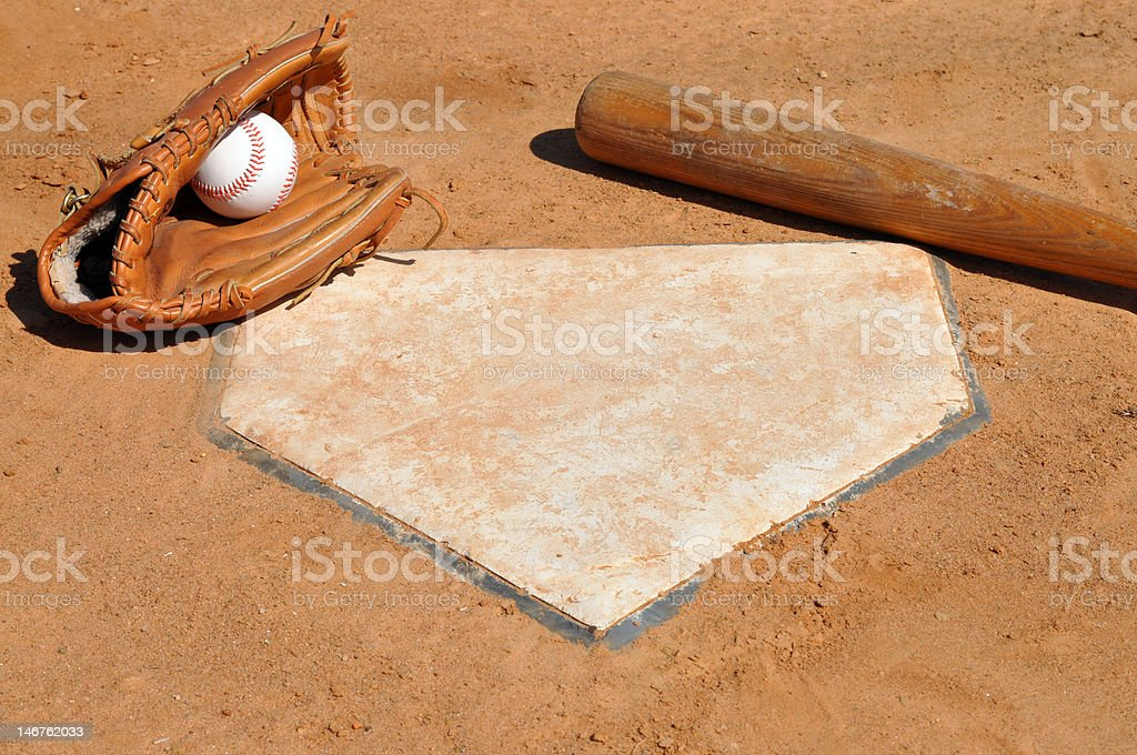 Baseball, Bat and Glove at Home Plate stock photo
