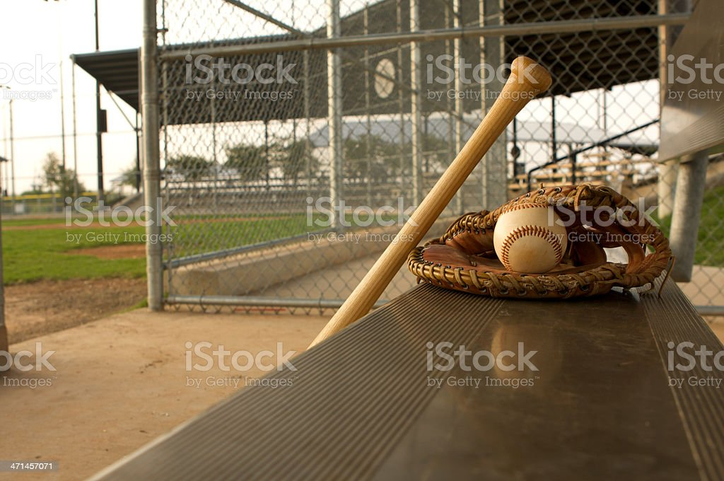 Baseball Bat and Glove in the Dugout stock photo
