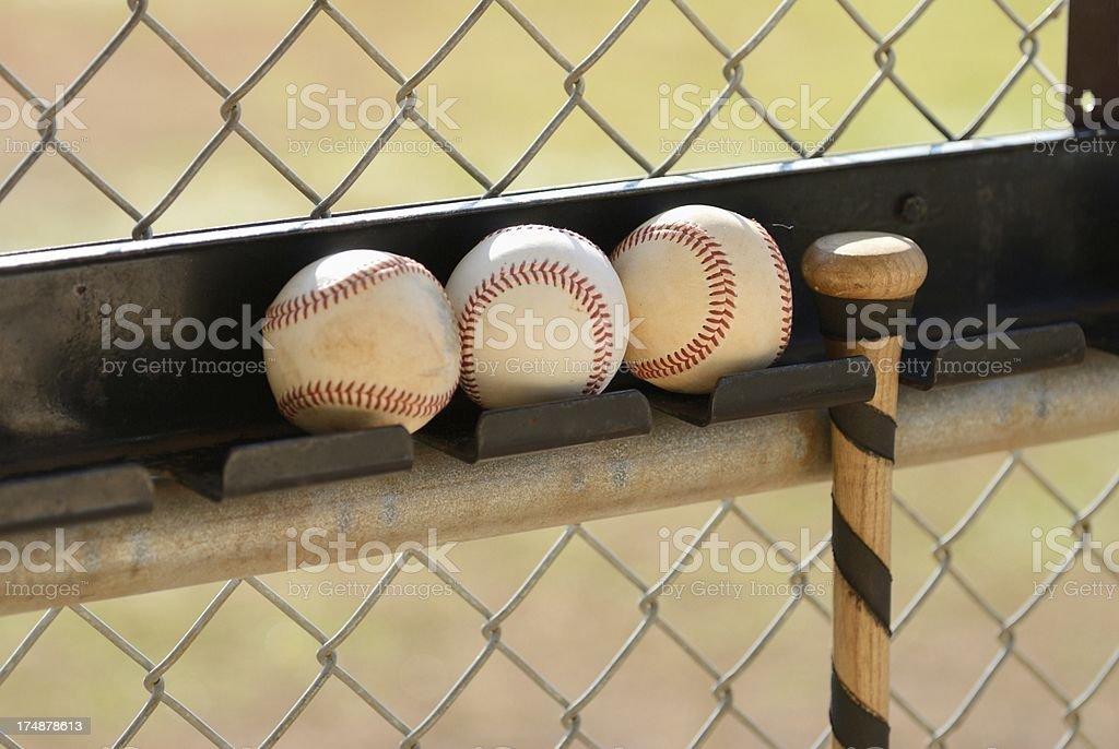 Baseball bat and three balls stock photo