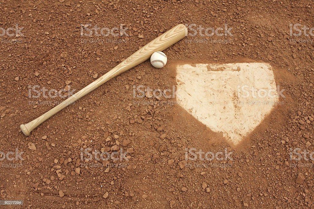 Baseball Bat & Ball near Home Plate stock photo