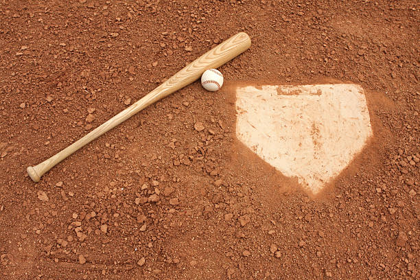 Baseball Bat & Ball near Home Plate stock photo