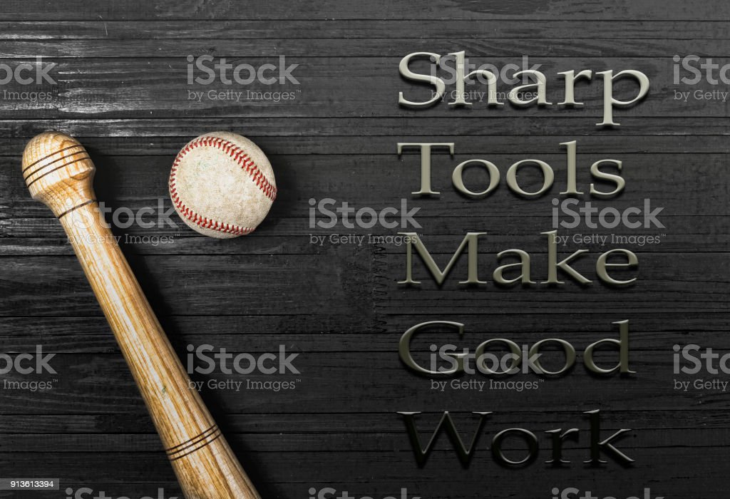 closeup of baseball bat and ball on wooden table with copy space....