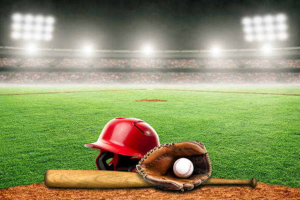 Baseball Bat, Helmet, Glove and Ball on Field in Outdoor Stadium With Copy Space stock photo