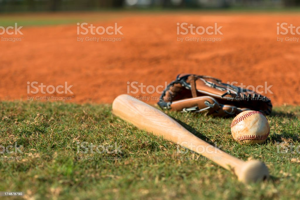 Baseball Bat Mitt and Ball on Diamond stock photo