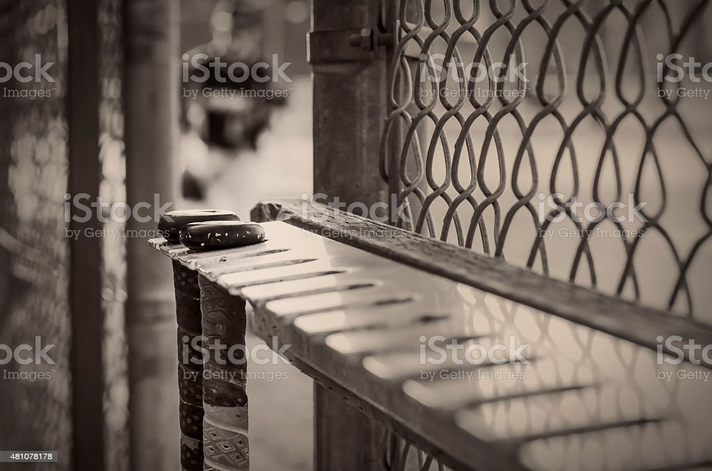 Baseball Bats Hanging in a Dugout stock photo