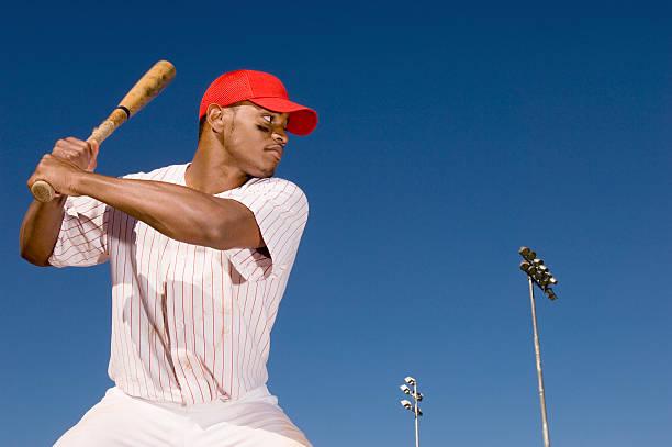 Baseball Batter Preparing to Hit Ball stock photo