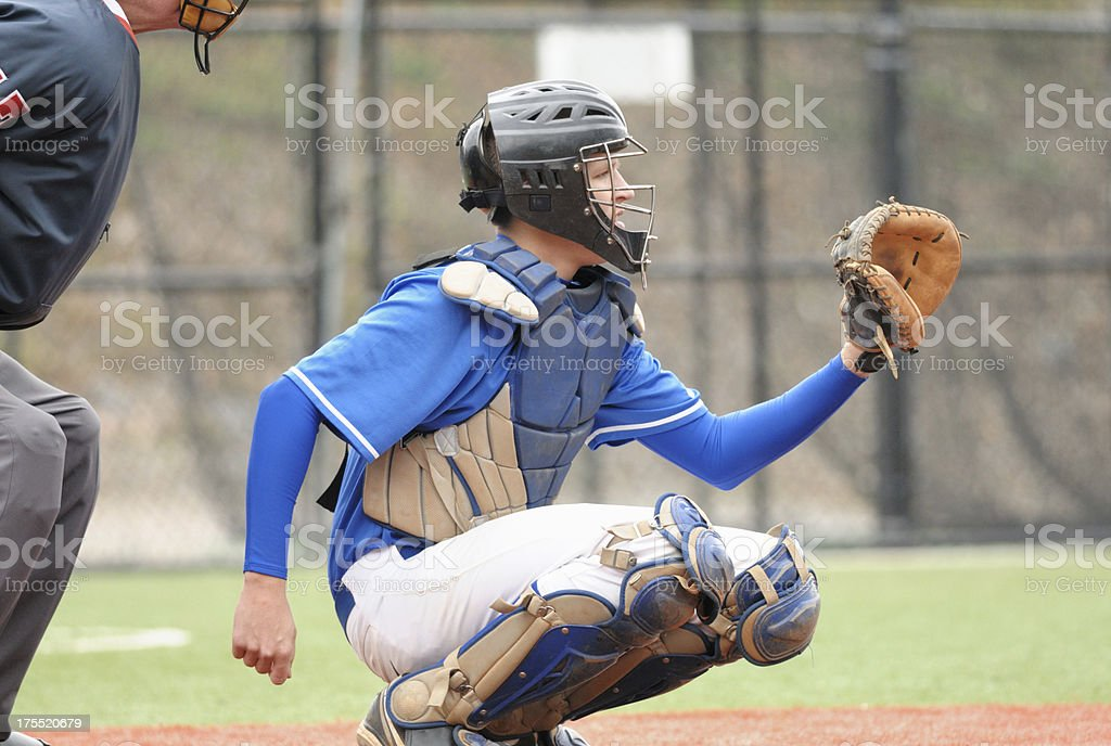 Baseball catcher behind home plate stock photo