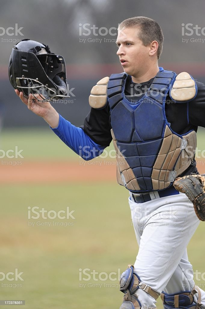 Baseball catcher headed to dugout stock photo