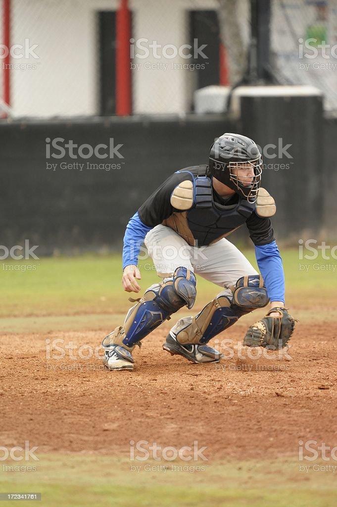 Baseball catcher preparing throw down to second base royalty-free stock photo