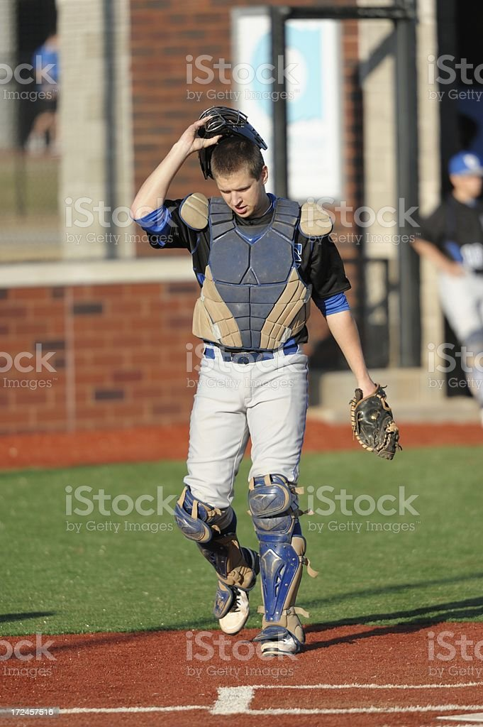Baseball catcher walking to home plate stock photo
