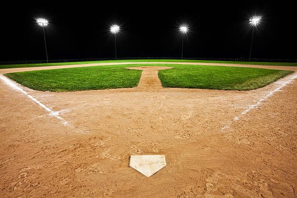 Baseball diamond at night stock photo