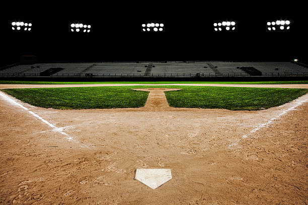 baseball diamond at night - softball stock photos and pictures