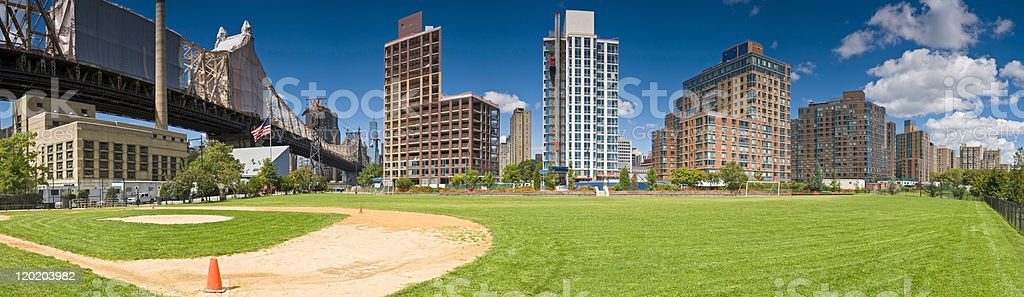 Baseball diamond Queensboro Bridge Manhattan apartment buildings New York panorama stock photo