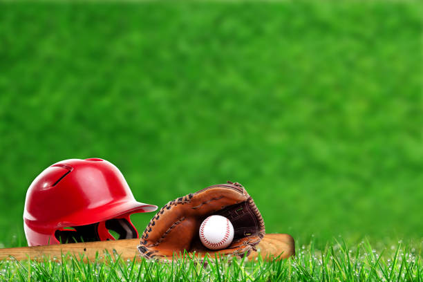 Baseball Equipment on Grass With Copy Space stock photo