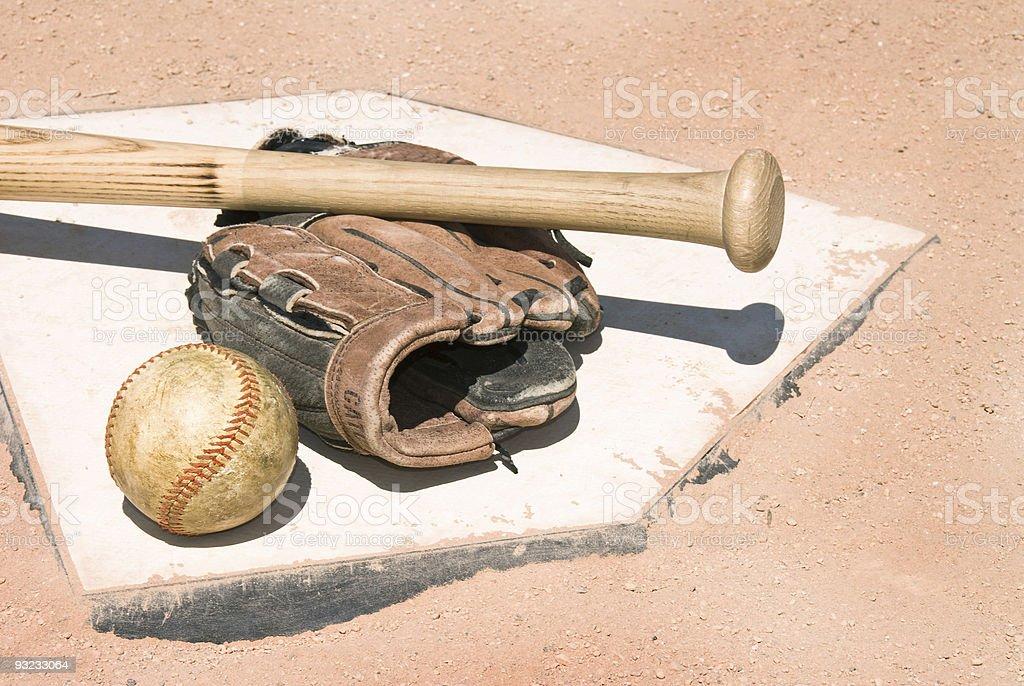 Baseball equipment on home plate stock photo