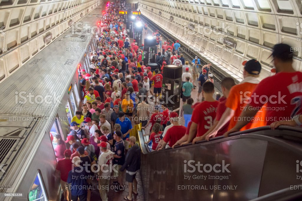 Baseball fans board a Metro train at the Navy Yard Ballpark station in Washington, DC. stock photo
